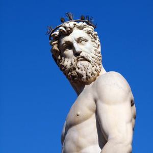 Statue of Poseidon with a blue sky in the background.