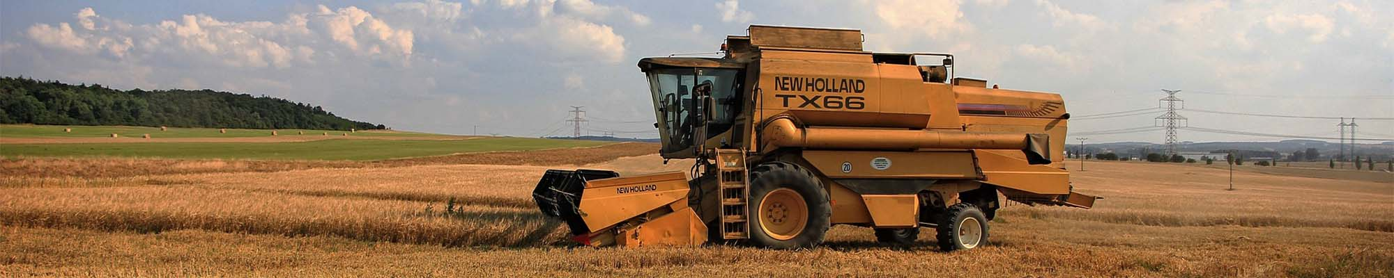 A Combine harvester working in a field